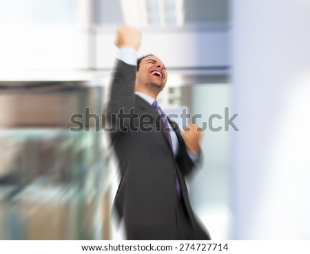 Portrait of a very happy businessman - stock photo