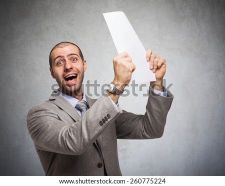 Portrait of a very happy businessman holding a document - stock photo