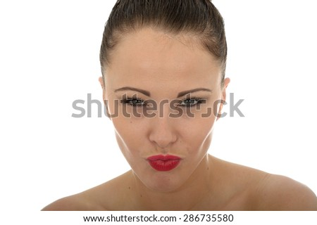 Portrait Of A Very Stern Evil Looking Beautiful Young Caucasian Woman With Her Lips Pursed In A Tense Pose Against White - stock photo