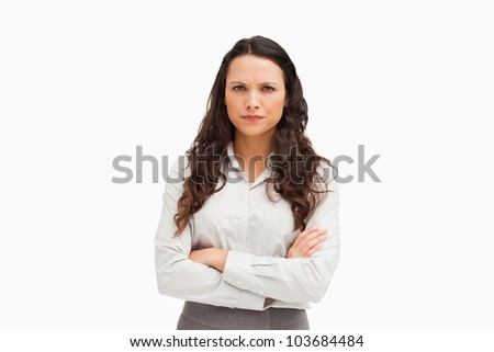 Portrait of a vexed employee against white background - stock photo