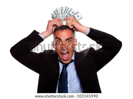 Portrait of a victorious mature person having fun with the earned money and wearing a black suit on isolated background - stock photo