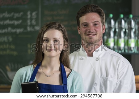 Portrait of a waitress and chef, smiling - stock photo