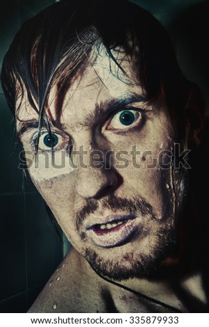 Portrait of a wet man with crazy eyes