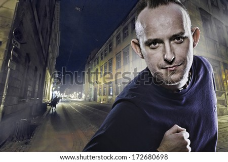 Portrait of a white man direct looking on night city composite background