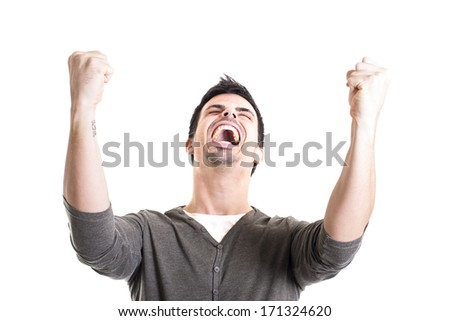 Portrait of a winner young man on white background - stock photo