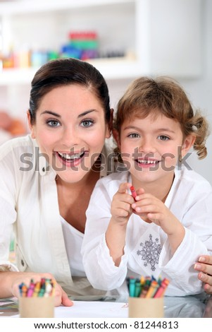 portrait of a woman and little girl - stock photo