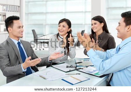 Portrait of a woman and man office workers  clapping salute their team - stock photo