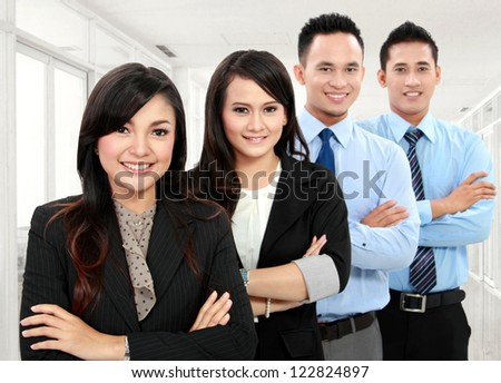 Portrait of a woman and man team in the office