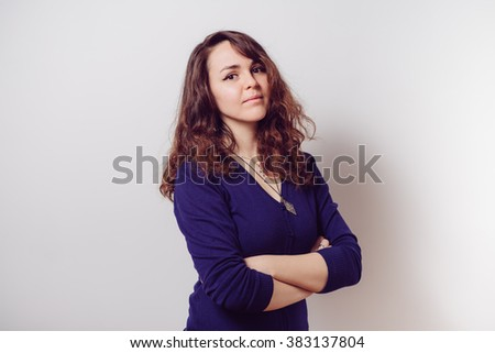 Portrait of a woman arms folded - stock photo