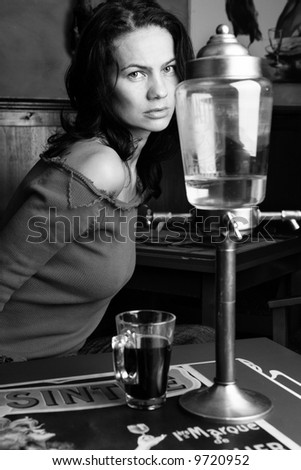 Portrait of a woman at absinthe bar - stock photo