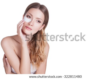 Portrait of a woman close-up, perfect skin on her face, he girl insulated on white background. She makes a mask under the eyes, skin nutrition, skin care. Cosmetology. Beauty. Makeup - stock photo