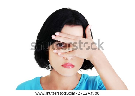 Portrait of a woman covering eyes because of shame - stock photo