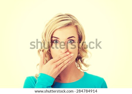 Portrait of a woman covering her mouth. - stock photo
