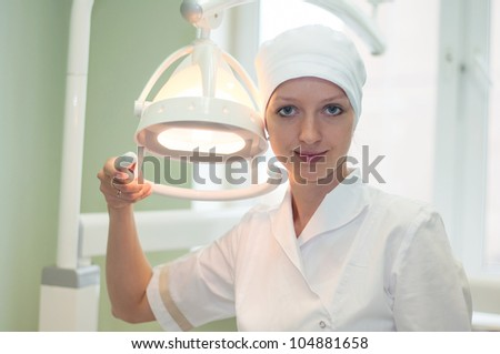 Portrait of a woman dentist in the clinic