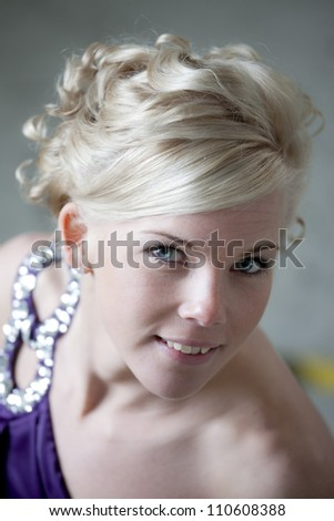 Portrait of a woman dressed in pink, posing at the dance floor. - stock photo