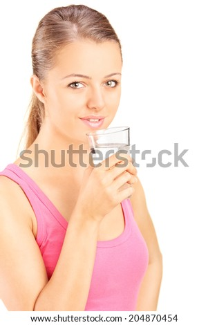 Portrait of a woman drinking water from a glass isolated on white background