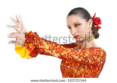 Portrait of a woman flamenco dancer wearing orange and yellow dress - isolated on white