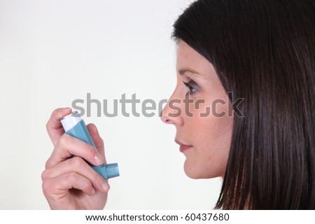 Portrait of a woman healing her asthma - stock photo