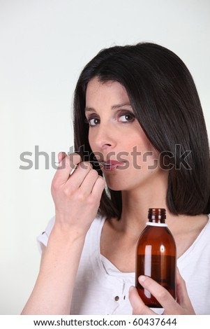 Portrait of a woman healing with a syrup - stock photo
