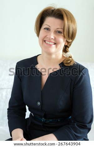 Portrait of a woman in a blue dress - stock photo