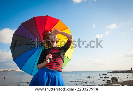 portrait of a woman in a clown outfit at Bay in the summer - stock photo