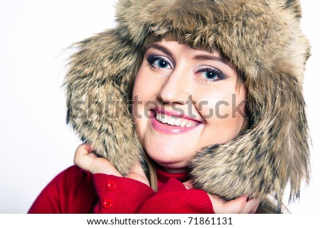 Portrait of a woman in a fur hat and a red sweater