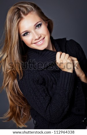 Portrait of a woman in a winter sweater - stock photo
