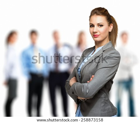 Portrait of a woman in front of a group of people - stock photo