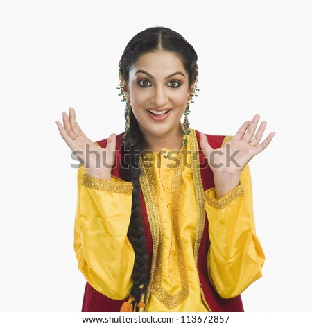 Portrait of a woman in yellow Punjabi dress
