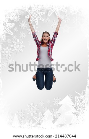 Portrait of a woman jumping against christmas frame