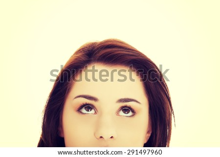 Portrait of a woman looking up - stock photo