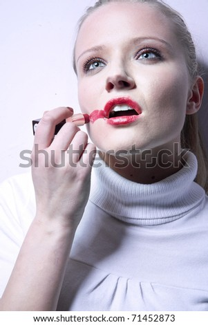 Portrait of a woman making up - stock photo