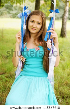 Portrait of a woman on a swing - stock photo