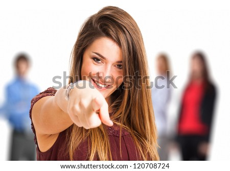Portrait of a woman pointing her finger to you - stock photo