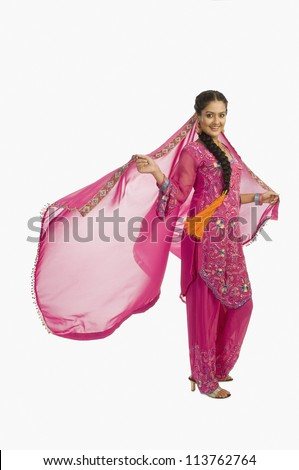 Portrait of a woman posing in salwar kameez - stock photo