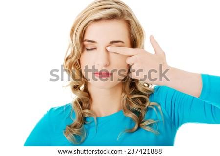 Portrait of a woman rubbing eyes. - stock photo
