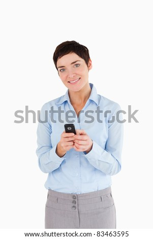 Portrait of a woman sending text messages against a white background