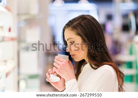 Portrait of a woman shopping in a beauty shop - stock photo