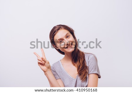 Portrait of a woman smiling and saying hello - stock photo