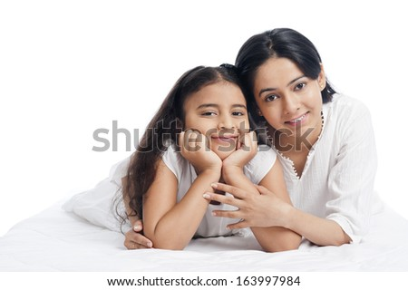 Portrait of a woman smiling with her daughter - stock photo