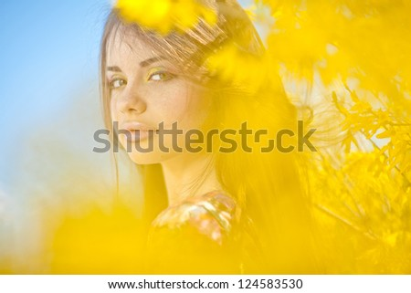 Portrait of a woman spring flowers - stock photo