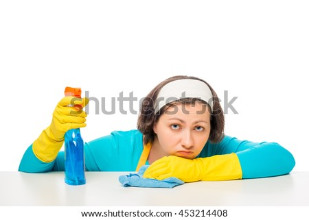portrait of a woman, tired of household chores on a white background - stock photo