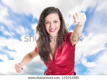 Portrait of a woman trying to fly - stock photo