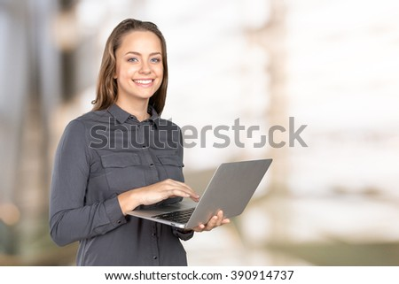 Portrait of a woman using a laptop