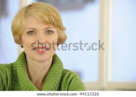 portrait of a woman wearing a green sweater with copyspace