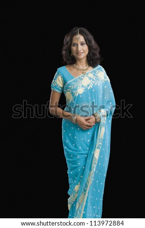 Portrait of a woman wearing a sari and smiling - stock photo