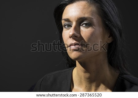Portrait of a woman with a blank expression - stock photo