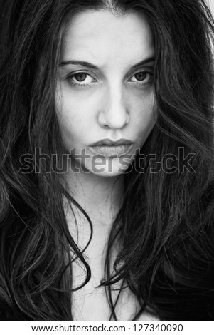 Portrait of a woman with a deep piercing eyes