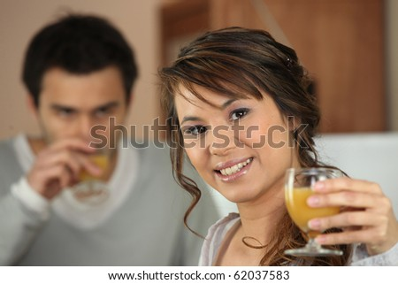 Portrait of a woman with a glass of orange juice