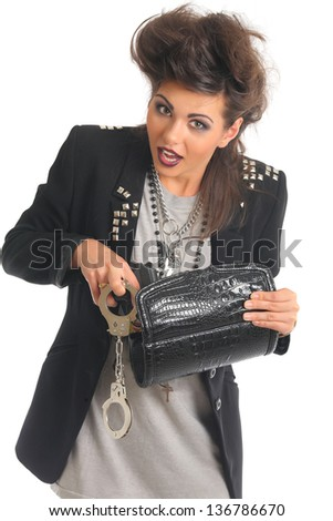 portrait of a woman with a gun and handcuffs - stock photo
